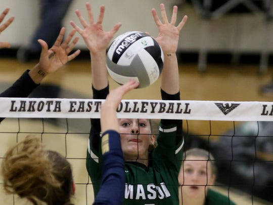 Mason's  Maggie King eyes the ball  during the Comets'