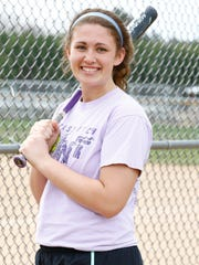 Merrill's Chelsey LaMonica poses for a photo during high school softball practice Monday at Merrill Area Recreation Complex.