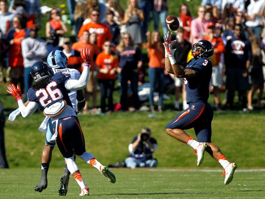 Virginia safety Quin Blanding (3) intercepts a pass intended for North Carolina wide receiver T.J. Thorpe (5) as he is defended by Virginia cornerback Maurice Canady (26) during an NCAA college football game in Charlottesville, Va., Saturday, Oct. 25, 2014. (AP Photo/The Daily Progress, Ryan M. Kelly)