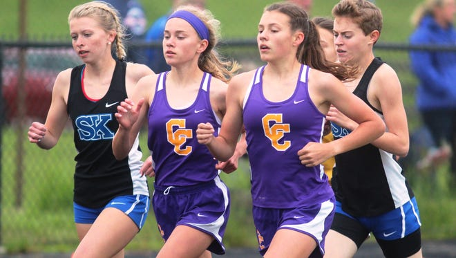 Girls 1600, from left, Meredith Hiles of Simon Kenton, Gracie Florimonte and Sidney Reagor of Campbell County, Mckenzie Lachmann of Simon Kenton.  KHSAA 3A Regional NKY track meet. May 21, 2016. Ryle HS. Union KY.