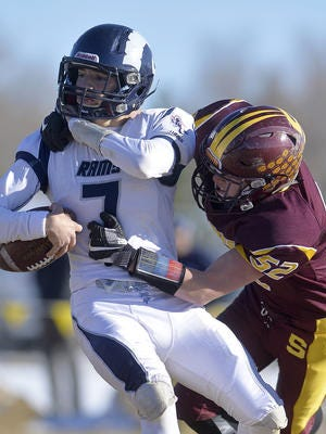 Shelby's Kade Leck records a sack on Loyola quarterback Scott Twite during Saturday's playoff football game.
