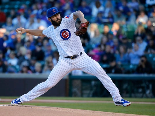 Chicago Cubs starting pitcher Jake Arrieta delivers during the first inning of a baseball game against the Miami Marlins Tuesday, June 6, 2017, in Chicago. (AP Photo/Charles Rex Arbogast)