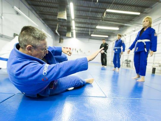 Sue Carter demonstrates a move to her gentle jiu-jitsu class on Saturday, Dec.16, 2017 at Gracie Barra Las Cruces Brazilian Jiu-Jitsu and Self-Defense.