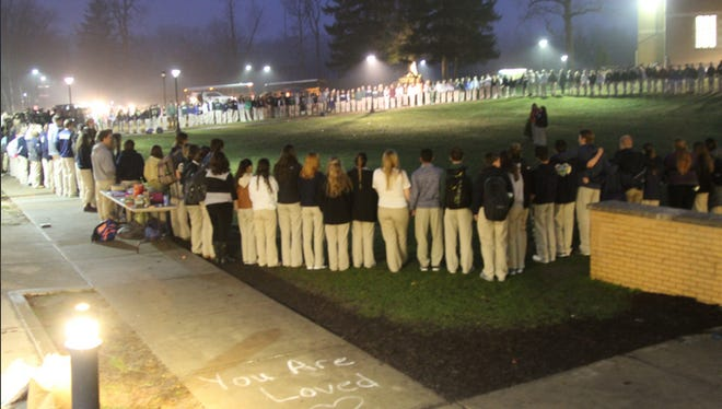 Cathedral High School students gathered Friday night for a vigil for Jennifer Maginot.