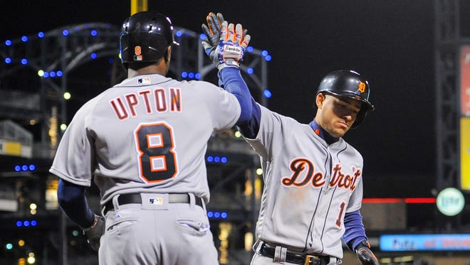 Jose Iglesias gets a high-five from Justin Upton of the Detroit Tigers after scoring in the ninth inning against the Pittsburgh Pirates on April 13, 2016, in Pittsburgh.