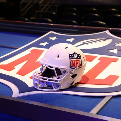 May 8, 2014; New York, NY, USA; A general view of a helmet and NFL shield logo before the start of the 2014 NFL Draft at Radio City Music Hall. Mandatory Credit: Adam Hunger-USA TODAY Sports