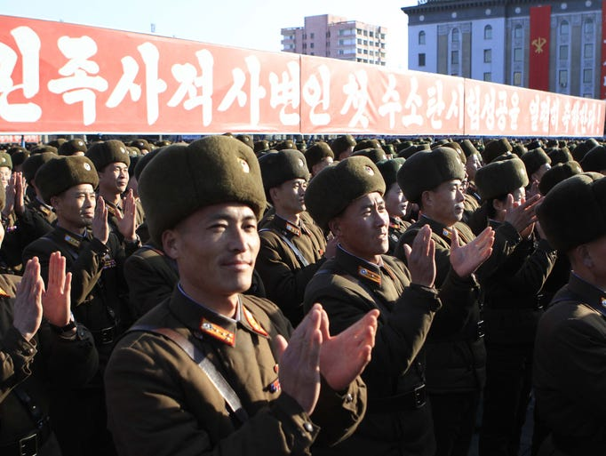 North Korean military personnel celebrate after North