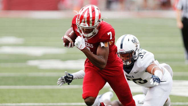 Indiana's Taysir Mac (7) carries the ball against Charleston Southern's Stefan Williams (35), during an NCAA college football game Saturday, Oct. 7, 2017, in Bloomington, Ind.