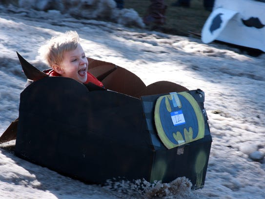 Jackson Hacker, 5, enjoys his cardboard sled ride during