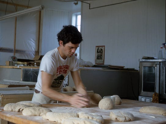 Chuck Conway shapes loaves of bread at O Bread Bakery