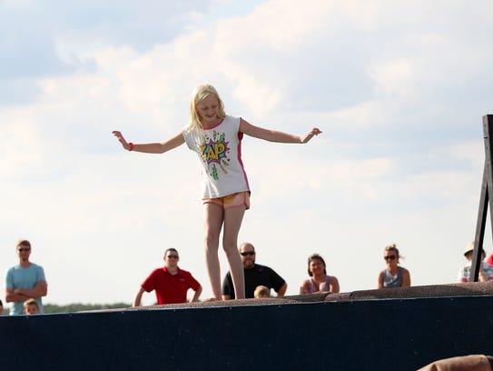 Nicole Wiley, 10, moves her feet to keep balance on
