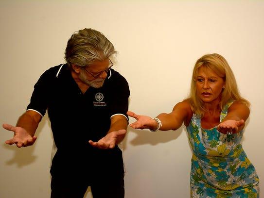 Harry Grimm, left, works with Kari Bone on foundation