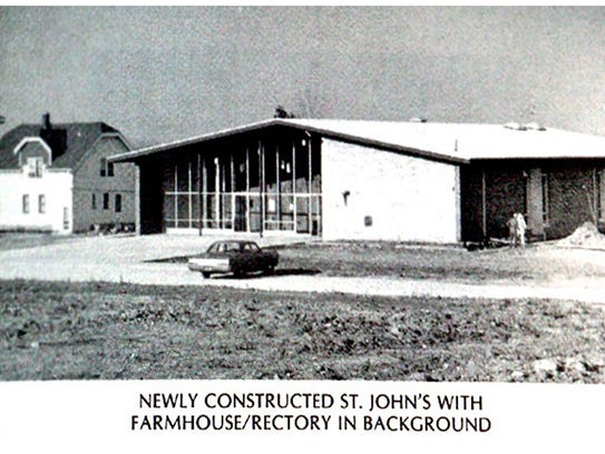 Newly constructed St. John's with farmhouse/rectory