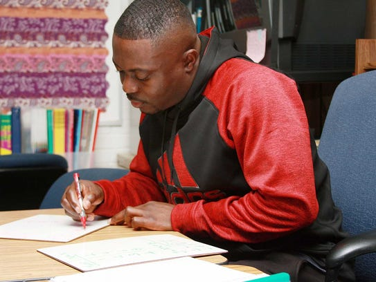Joseph Abangs works on Linear Equations during Tuesday's