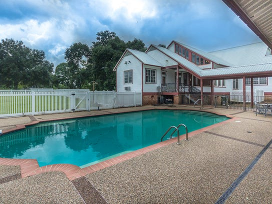 The outdoor pool also has a pool house and game room