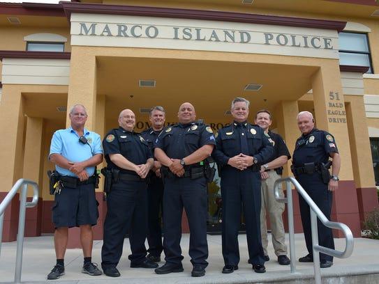 Police officers Bob Marvin, from left, Capt. Dave Baer,