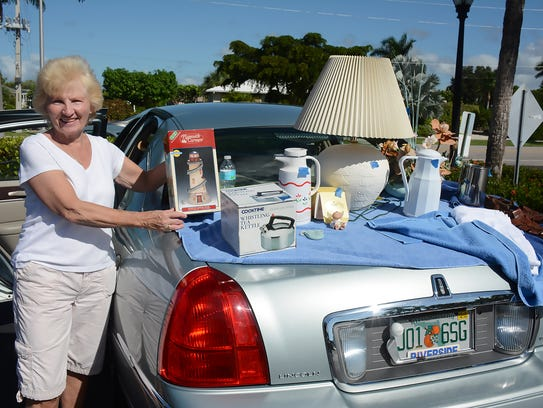 Karen Froyo pushes a trunkful of items including a