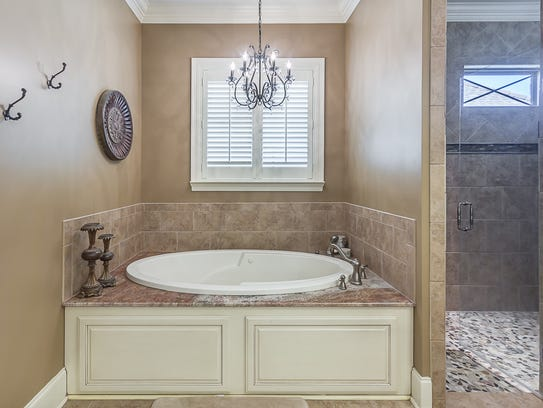 The master bath has designer fixtures and huge closets.