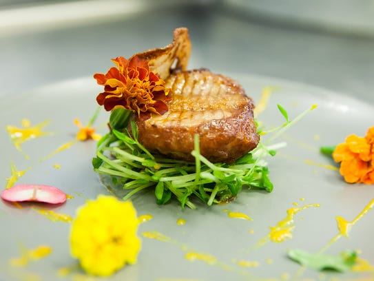 Huy Hoang's catfish dish is served sitting on a bed