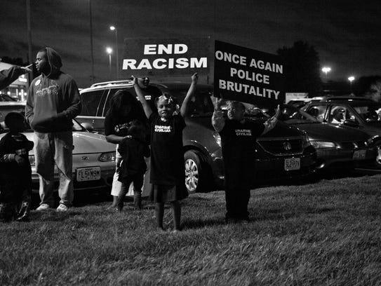A scene from 'Whose Streets?' shows protesters in Ferguson,