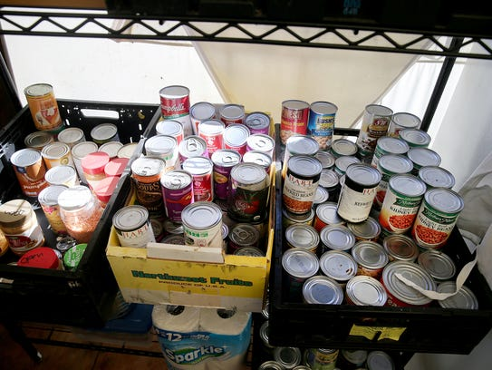 Canned food in the common kitchen in Seattle's Tiny Home Village. Residents get a small space in a shared refrigerator.