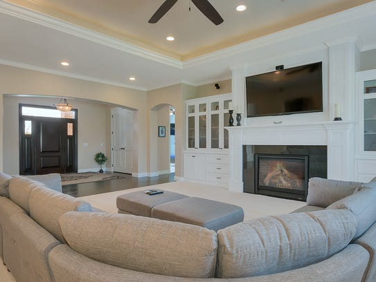Enjoy a warm fire in the living room at 21096 Westbrook