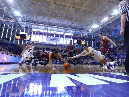 UNI's Bennett Koch dives for a loose ball during Sunday's