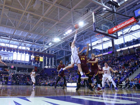 UNI's Bennett Koch throws up a layup during Sunday's