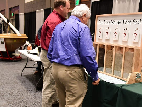 "Two Fort Wayne Farm Show visitors puzzle over the ""Name"