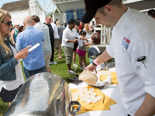 A Virginia Beach visitor prepares to sample the dish