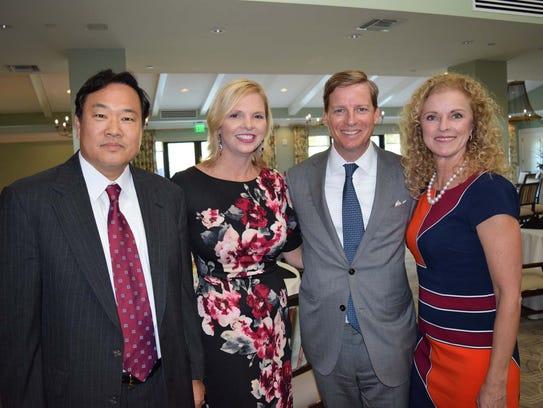 Derek Hong, left, Christine DelVecchio, Bob Dunkin