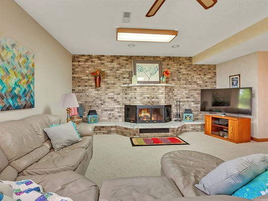 The lower level offers a wood burning brick fireplace complete with a large hearth and mantle.