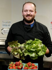 Jordan Stephenson, owner/chef,  is photographed with fresh Kentucky grown produce at Stephenson Mill Tavern & Grill in Walton.
