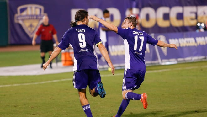 Louisville City FC's Matt Fondy (#9) celebrates with teammate Niall McCabe after he scores a goal. Aug. 22, 2015