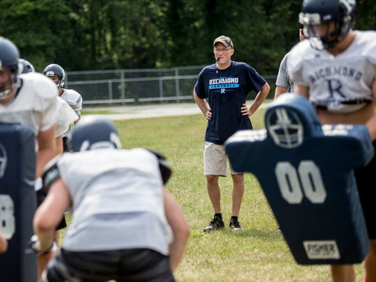 Coach John Kocher watches the action during football practice Thursday, August 11, 2016 at Richmond High School.