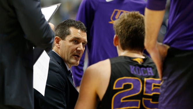 Northern Iowa head coach Ben Jacobson huddles with his team during the first half of an NCAA college basketball game against Xavier, Saturday, Nov. 26, 2016, in Cincinnati.