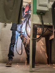 Student at work in the welding shop.