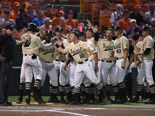 Vanderbilt players celebrate with Will Toffey, left,