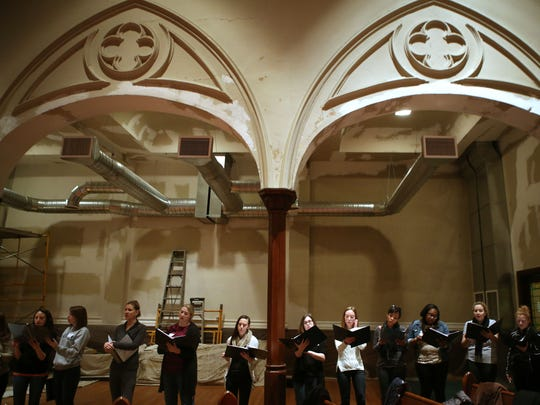 "The YP Choral Collective rehearses for their ""Cin and Tonic"" concert at First Lutheran Church, Over-the-Rhine."