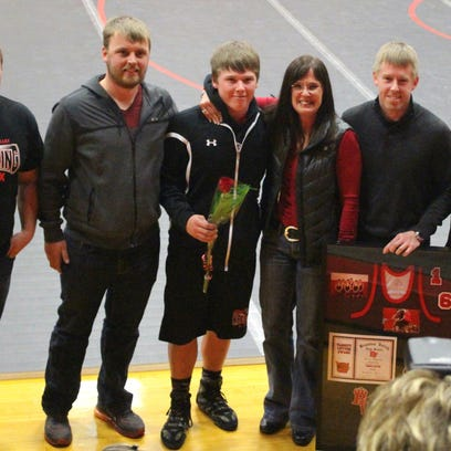 Brandon Valley senior Brad Gingles give his mom a rose and she give him a shadowbox to remember the years of hard work in wrestling.