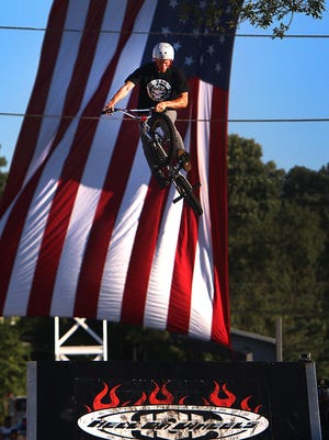 Shawn Veneerable from Brick and riding with the Hell on Wheels doing a jump at National Night Out in Piscataway Tuesday August 4, 2015 photo by Ed Pagliarini