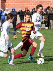 Ithaca senior Tristan Cornell-Roberts dribbles up the