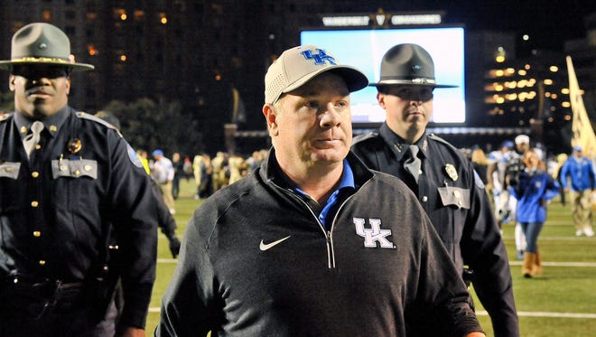 Nov 14, 2015; Nashville, TN, USA; Kentucky Wildcats head coach Mark Stoops walks off the field after his team is defeated by the Vanderbilt Commodores during the second half at Vanderbilt Stadium. Vanderbilt won 21-17.