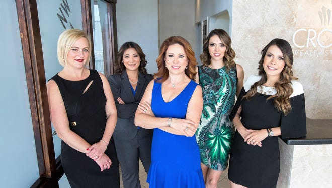 Lizzie Dipp Metzger, center, and her team at Crown Wealth Strategies in El Paso. Metzger was New York Life's top producer in 2016 among 12,000 agents and financial advisers nationwide. From left are Sumer Rose-Nolen, Emikoryo Perkins, Metzger, Paulette Acosta-Hayen and Cynthia Loya.