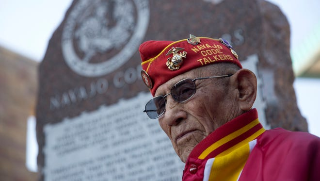 Navajo Code Talker John Kinsel Sr. stands next to a memorial dedicated to the Navajo Code Talkers Friday during an unveiling ceremony at the San Juan County Administration Offices in Aztec.