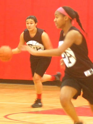 Elmwood Park junior forward Alyssa Barrios dribbling down the floor with sophomore Ilionie Isabel in a recent scrimmage at home against Fair Lawn.