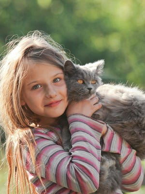 Living with cats and cockroaches may reduce kids' asthma risk (Dreamstime/TNS)