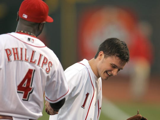 Josh Hutcherson shakes hands with Cincinnati Reds Brandon Phillips after throwing out the first pitch during pre-game in 2012.