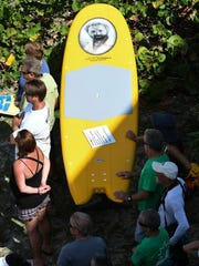 Shaper Ricky Carroll made this board in memory of Dick Catri during Saturday's Paddle Out for the legendary East Coast surfer at Sebastian Inlet.