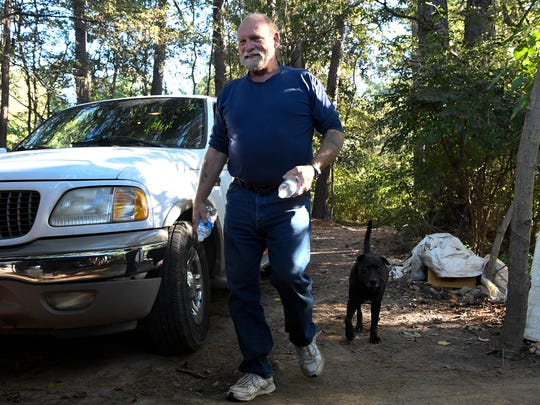 Wendell Segroves spends time with his dog Argo at his campsite Wednesday, Oct. 18, 2017, in Nashville. Segroves has been homeless since 2004.